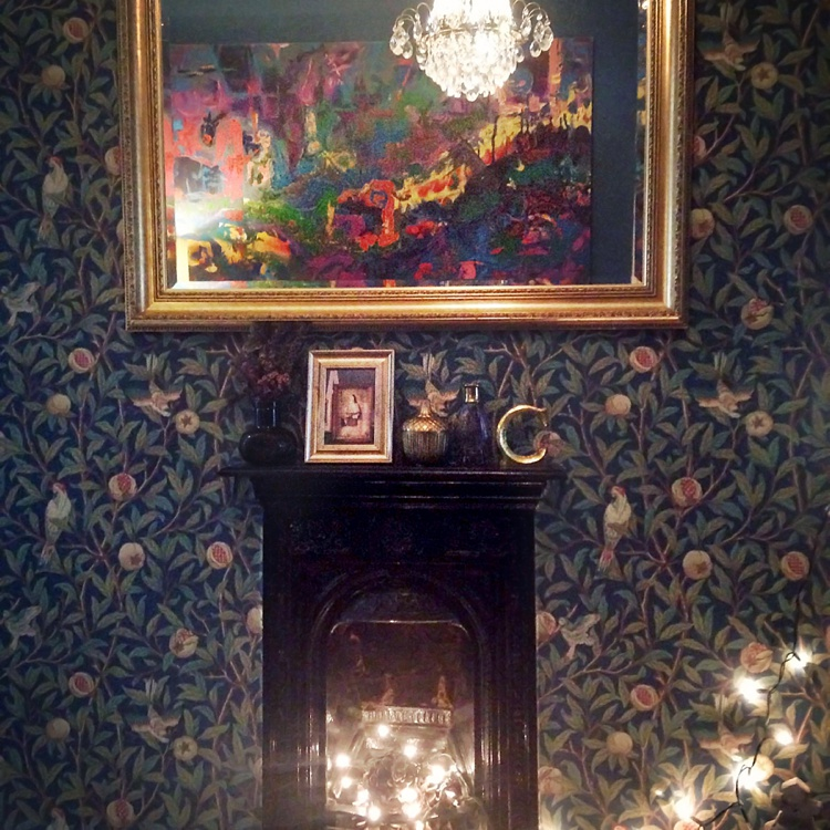 interior design london dark walls midnight blue gold gilded mirror victorian fireplace lily sawyer photo
