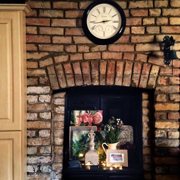 interior design london original victorian oven chimney faux flowers lily sawyer photo